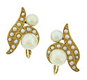 These spectacular estate earrings feature curling figures of 14K yellow gold set with cultured pearls