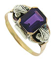 This wonderful antique estate ring is set with a gorgeous emerald cut amethyst