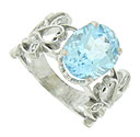 A breathtaking aquamarine appears to float amidst delicate cutwork vines on the face of this romantic estate ring