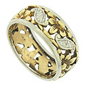 Fantastic floral cutwork and engraving dance across the surface of this breathtaking antique wedding band