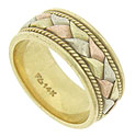 Thick ribbons of white, yellow and rose gold are braided together at the center of this handsome estate wedding band