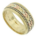 Layers of braided yellow, white and rose gold press together in this wide yellow gold wedding band