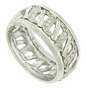 A ribbon of organic cutwork figures press together on the face of this elegant antique wedding band