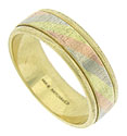 A bold center stripe of white, yellow and rose gold adorns the face of this handsome mens wedding band