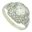 A spectacular .95 carat, E color, Si2 clarity diamond glows from the face of this antique platinum engagement ring