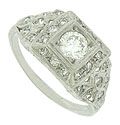 A dazzling GIA certified, .41 carat, F colored, Si2 clarity round cut diamond glows from the face of this antique engagement ring