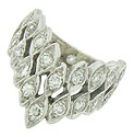 A double row of diamond frosted leaves drapes down the face of this dazzling vintage wedding band
