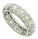 Intricate abstract organic cutwork and engraving cover the surface of this elegant 18K white gold wedding band