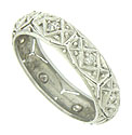 Fantastic abstract organic cutwork and engraving cover the surface of this antique wedding band