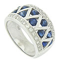 This breathtaking antique style wedding band features deep blue sapphires and sparkling diamonds