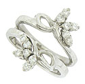 Abstract floral figures appear to sprout from the face of this vintage 14K white gold engagement ring bracket