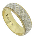 A rough, crosshatch pattern covers the surface of this estate wedding band