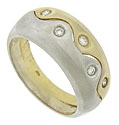 A pair of undulating white and yellow gold bands press together to form this distinctive estate wedding band