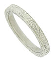 Deeply engraved leaves dance across the surface of this handsome platinum wedding band