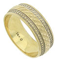 Layers of intricate engraving decorate the surface of this handsome 14K yellow gold wedding band