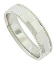 Brightly polished facets cover the surface of this classic 14K white gold wedding band