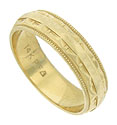 Layers of simple engraving, framed in bold milgrain adorn the surface of this handsome vintage wedding band