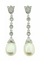 These glorious antique style earrings feature luminous tear shaped pearls