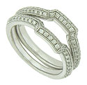 Squared off curves are set with faceted round diamonds on this 14K white gold antique style wedding band