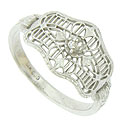 Intricate lacy cutwork and abstract floral engraving adorn the face of this elegant engagement ring