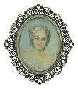 This romantic antique portrait pin features a porcelain skinned beauty in a powdered wig