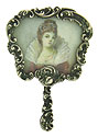 A porcelain skinned Victorian beauty is the focus of this beautifully painted antique portrait pin