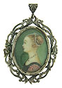 This elegant portrait pin features an 18th century beauty done in profile