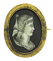 This spectacular antique portrait pin features a highly detailed woman in profile