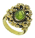 A luminous oval cut Peridot glows from the face of this spectacular vintage estate ring