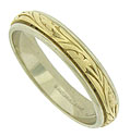 Elegant Art Deco style engraved flowers and leaves stretch across the face of this antique style bi-colored wedding band