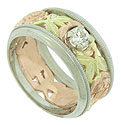 This romantic antique style wedding band features a floral cutwork design of red gold roses and green gold leaves
