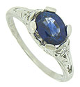 A marvelous 1.29 oval cut sapphire glows from the face of this handsome antique style engagement ring