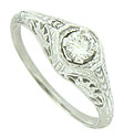 A brilliant .21 carat, H color, Si1 clarity diamond glows from the face of this floral inspired engagement ring