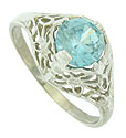 A fabulous 1.88 carat blue zircon is the focus of this splendid antique style engagement ring