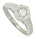 Engraved roses and ribbons cover the shoulders of this elegant antique style ring