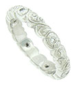 Abstract organic cutwork covers the surface of this romantic antique style wedding band