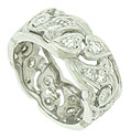 Bold, abstract organic cutwork spins across the surface of this elegant vintage wedding band