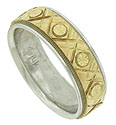 This handsome estate wedding band is fashioned of white gold and features a center yellow gold band adorned with deeply engraved cross hatching and abstract daisies