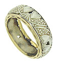 Engraved hearts and flowers adorn the surface of this bi-color estate wedding band