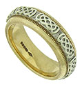 This Celtic inspired estate wedding band features a white gold central ribbon adorned with braided figures