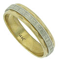 Organic engraving adorns a white gold ribbon encircling the face of this handsome 14K yellow gold wedding band
