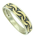 Bold, roughly engraved links of yellow gold press into the face of this white gold estate wedding band