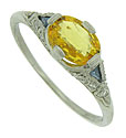This captivating engagement ring features a dazzling  1 carat oval cut yellow sapphire