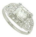 This exquisite antique engagement ring features a .86 carat, GIA certified, G color, Vs1 clarity round diamond