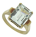 A spectacular 5.89 carat, emerald cut aquamarine glows from the face of this handsome estate ring