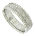 Ribbons of impressed circles frame a mottled surface on the face of this modern mens wedding band