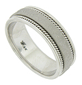 A satin finished band impressed with repeating snake skin pattern is the focus of this handcrafted 14K white gold mens wedding band