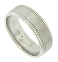 This mens wedding band features a satin finished surface flanked by impressed milgrain with polished edges