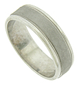 A wide ribbon of sanded white gold covers the face of this antique style wedding band