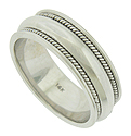 This handsome wedding band features a rounded, faceted white gold band adorned with bold twisting ropes of gold